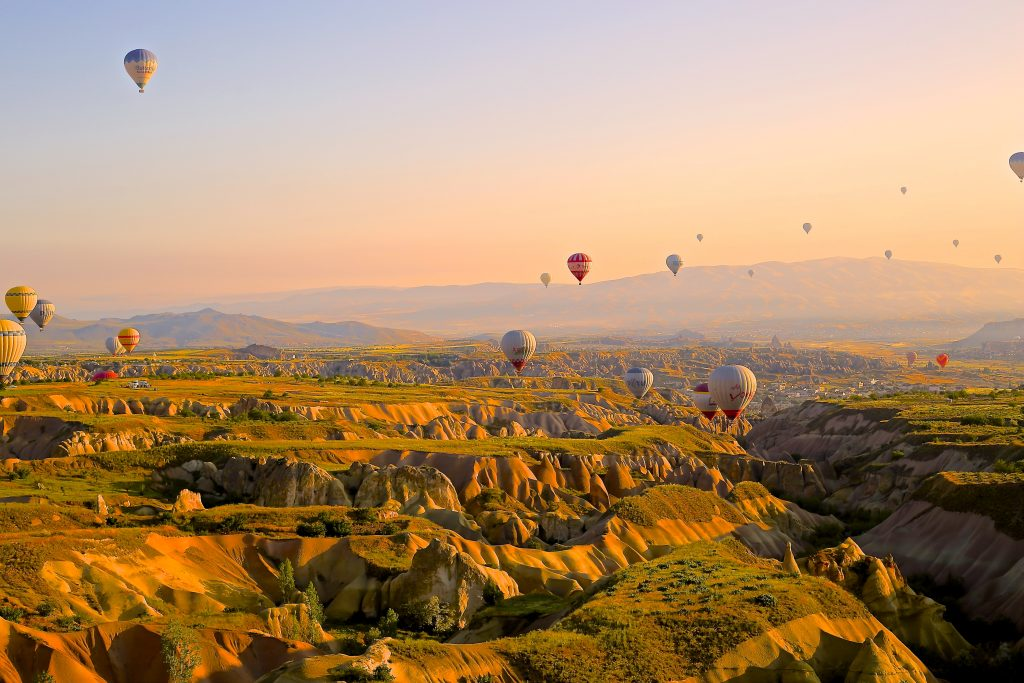 Image of hot air balloons flying over landscape